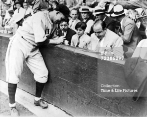 Gangster Al Capone and his son having baseball autographed by player Gabby Hartnett - Photo from GettyImages.com