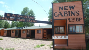 Black and Orange Cabins You park your car in the garage next to your room